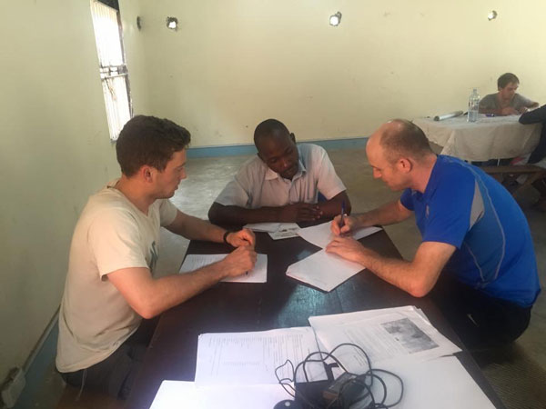 The International Runners Ian & Johnny work with a Uganda student to develop a business plan